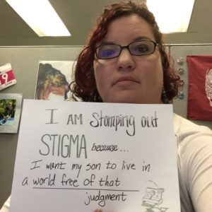 Kristen holding a sign: I am stomping out stigma because I want my son to live in a world free of that judgment